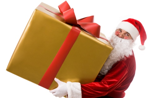 Photo of happy Santa Claus with big giftbox in hands