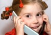 Little girl talking on two mobile phones