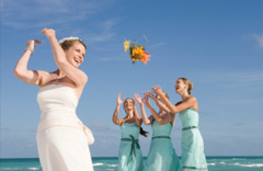 Bride throwing bouquet